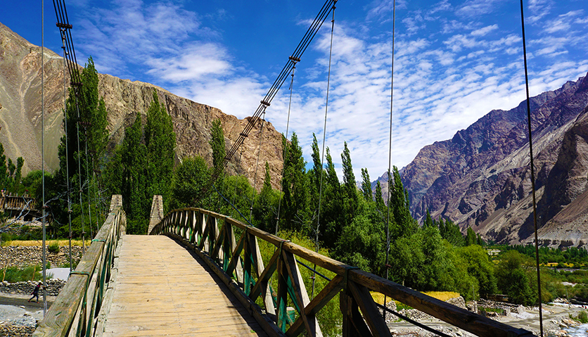 wooden bridge with nature in nubra valley in turtuk leh ladakh. turtuk is a village 205 km from leh on the banks of shyok river near pakistan